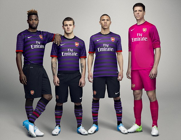 59ce79f1ad1 Arsenal new kit. The Gunners have unveiled their striking purple and black  hooped design - along with a garish bright pink goalkeeper's strip - and  revealed ...